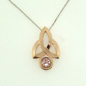 14k rose gold Celtic style pendant featuring a 0.803ct pink sapphire.
