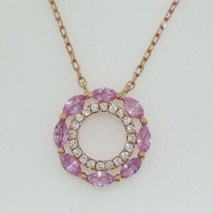 14 karat rose gold pendant featuring a circle of marquise cut pink sapphire and an inner circle of round brilliant cut diamonds.