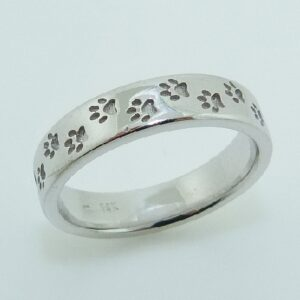 This 14 karat white gold dog paw print band is sure to please all the dog lovers out there!