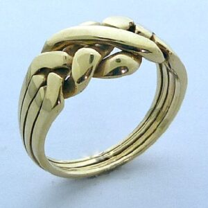 Puzzle ring 14 Karat Yellow gold consisting of four rings interlocked.