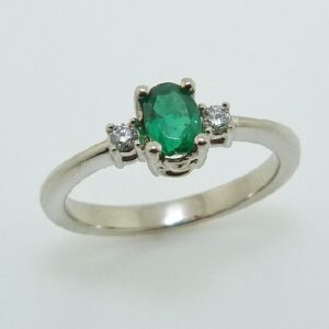 14 karat white gold ring set with a 0.44ct emerald and 2 = 0.06ctw round brilliant cut diamonds