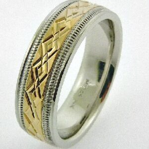 14 Karat white and yellow gold men's 7mm band with yellow gold interlocking pattern in centre and milgrain detail.