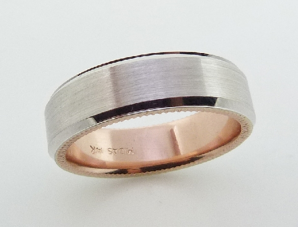 14 Karat white gold 7mm beveled edge band with a rose gold sleeve accented with a stainless finish in the centre and polished edges and a coin edge detail.