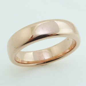14 Karat rose gold 6.5mm polished domed band.