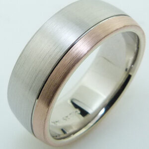 14 Karat white and rose gold two-tone domed 8mm band with a satin finish and polish stripe.