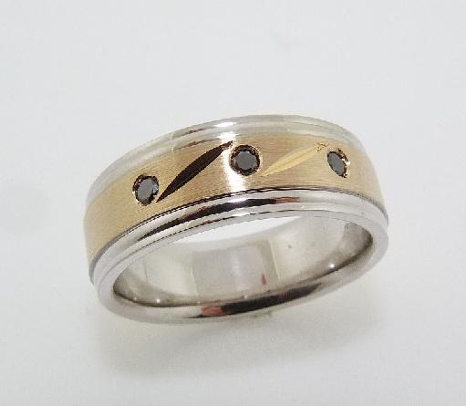 14K White and yellow gold men's band with detailed accents and 3 gypsy set round brilliant cut black diamonds, 0.09cttw.