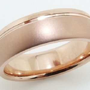 14 Karat rose gold 6.5mm domed band with a satin and polish finish.