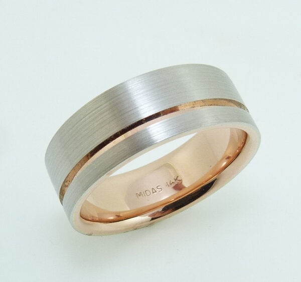 14 Karat rose & white gold 8mm flat band with a stainless texture and polished rose gold inlay and sleeve.