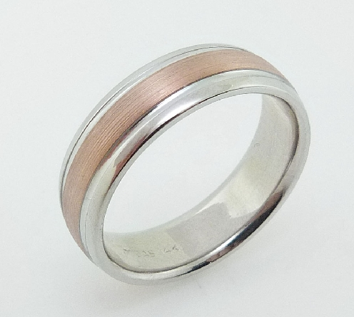 14 Karat rose & white gold 7mm domed rounded edge band with stainless texture rose gold centre and white gold polished edges.