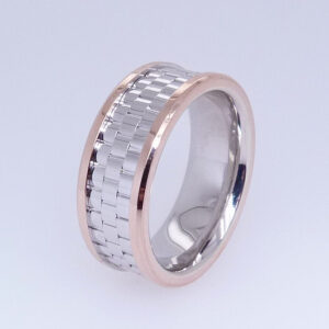 14 Karat white and rose gold two-tone piepstyle 8mm band with a textured polished finish centre and rose gold edges.