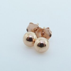 14 karat rose gold 4mm high polish stud earrings.