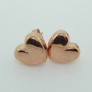 14 karat rose gold heart shaped stud earrings.