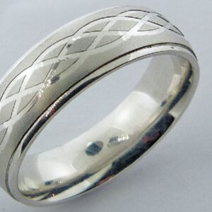 14K White gold domed men's 6.5mm band with etched celtic knot design in the center and polished edges.