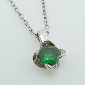 14K White gold coloured gemstone halo pendant set with a 1.02 carat oval Tsavorite garnet accented with a petal like halo, 0.145cttw round brilliant cut diamonds, G/H, VS-SI.