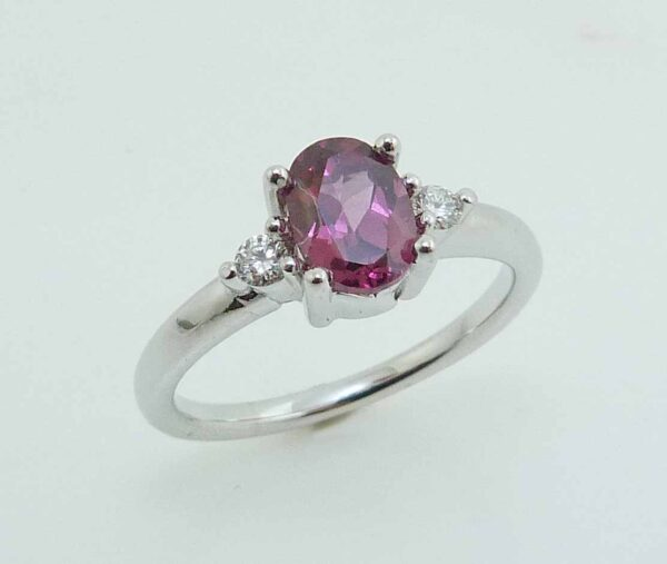14k white ring set with a 0.91ct rhodolite garnet and 2 round brilliant cut diamonds, 0.086ctw, very good cut, I/J, SI2/I1.
