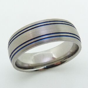 Titanium with a blue anodized stripe finish band by Lashbrook Designs.