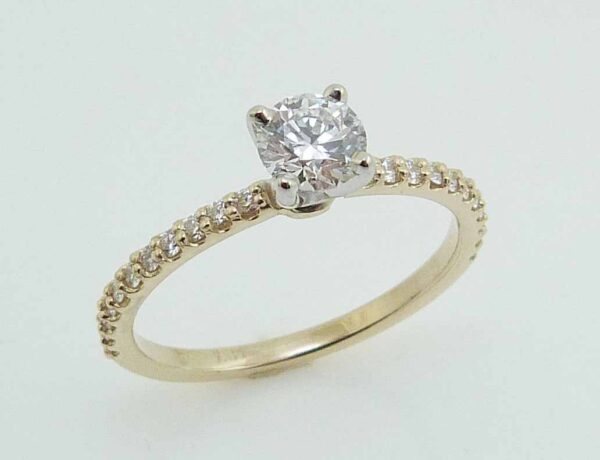 14KYW engagement ring set with one 0.438ct G, SI1 ideal cut, round brilliant cut Hearts On Fire diamond and accented on the 22 Hearts On Fire diamonds, 0.191cttw, G/H, VS-SI.