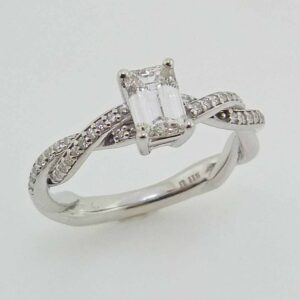 14 karat white gold solitaire engagement ring featuring a 0.70ct H, VVS emerald cut diamond and accented by 34 = 0.16cttw H/I, SI2 round brilliant cut diamonds.