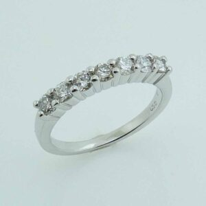 14 karat white gold band with 7 = 0.61cttw I/J, SI2, excellent cut round brilliant cut diamonds.