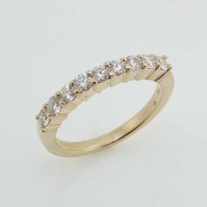 14 karat yellow gold band with 9 = 0.45cttw I/J, SI1, excellent cut round brilliant cut diamonds.