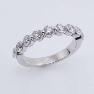 14KW lady's band shared prong set with 9 round brilliant cut diamonds, 0.89cttw, G/H, VS-SI.