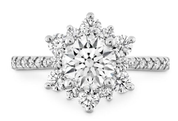 The perfect diamond engagement ring for the woman who wants simple but dazzling. A wreath of Hearts On Fire diamonds encircle the perfectly cut center diamond, creating a truly elegant and unique look.