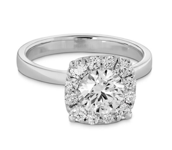 18kw engagement ring by Hearts On Fire set with one 0.552ct I, VS1 ideal cut, round brilliant cut Hearts On Fire diamond and accented on the halo with 0.13cttw, G/H, VS-SI round brilliant cut diamonds.