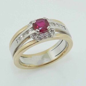 14k white and yellow gold ring set with 0.40ct cushion cut Ruby and accented with 10 = 0.06cttw G/H, SI and 8 = 0.276cttw G/H, VS-SI princess cut diamonds.