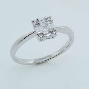 14k white gold engagement ring set with 5 = 0.19cttw G/H, SI, baguette cut diamonds and 4 = 0.04cttw G/H, SI round brilliant cut diamonds.
