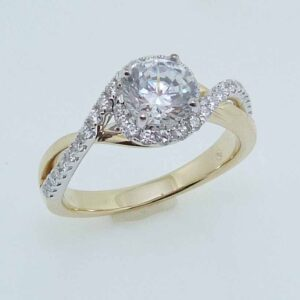 14KWY bypass style engagement ring set with a round 0.75ct CZ and 36 round brilliant cut diamonds on the band totaling 0.30 carats, H/I, SI.