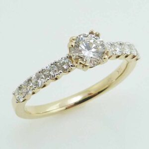 14K Yellow engagement ring claw set with a 0.43ct ideal cut round brilliant cut diamond, I, SI2 and claw set on the band with 10 round brilliant cut diamonds, 0.41cttw, H/I, SI1-2.