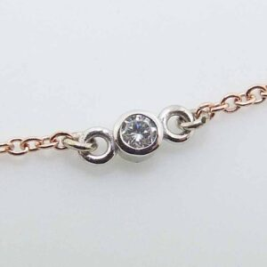 "14k rose gold 18"" chain and pendant bezel set with a 0.065ct H/I, I1 round brilliant cut diamond."