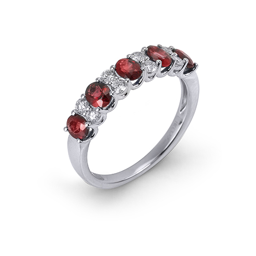 14K White gold ring with five oval rubies totaling 1.17 carats and eight round brilliant cut diamonds totaling 0.27 carats.