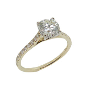 14K White and yellow gold solitaire engagement ring set with an ideal cut, round brilliant cut Hearts On Fire diamond, 1.051ct, J, VS2 and accented with 26 claw set round brilliant cut diamonds, 0.28cttw diamonds, G/H, SI.