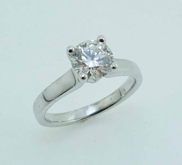 14K White gold solitaire engagement ring set with an ideal cut, round brilliant cut Hearts On Fire diamond, 1.051ct, J, VS2.