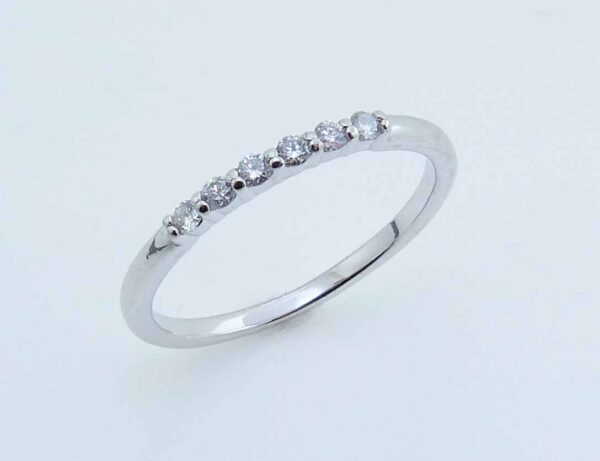 Lady's white gold 10K ring set with six H, SI1-2, very good cut round brilliant cut diamonds totaling 0.12 carats.