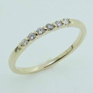 Lady's yellow gold 10K ring set with six H, SI1-2, very good cut round brilliant cut diamonds totaling 0.12 carats.