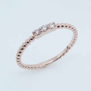 14K Rose gold diamond lady's ring claw set with 3 round brilliant cut diamonds, 0.095cttw, I/J, SI2, ideal cut.