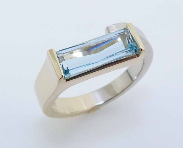 14 karat white and yellow gold ring set with a 1.31ct Aquamarine. This beautiful ring is a custom Design by David.