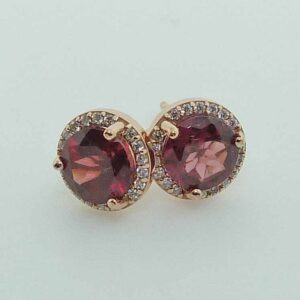 14k rose gold halo stud earrings set with 2 = 2.14cttw rhodalite garnets and accented with 0.10cttw G/H, I1 round brilliant cut diamonds.