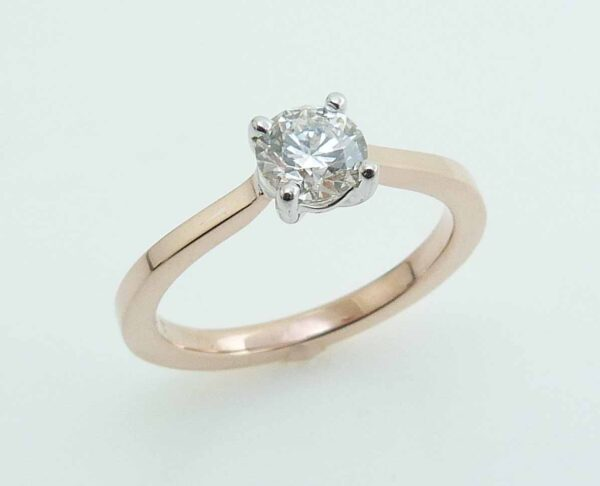 14K Rose and white solitaire engagement ring set with a 0.518 carat, H, SI1 Hearts On Fire diamond.