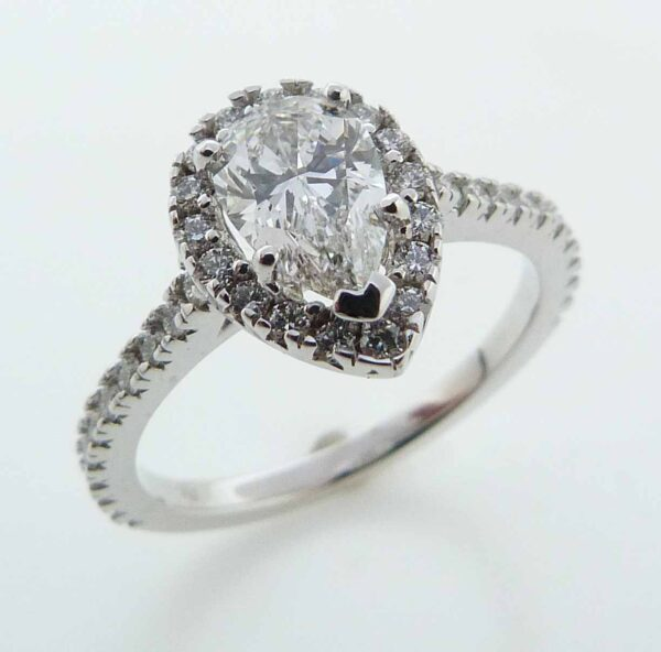 14 karat white pear shape halo engagement ring featuring a 0.71ct G SI1 pear shape diamond, GIA graded and 39 round brilliant cut diamonds, 0.39cttw F/G, VS2-SI1 excellent cut. This unique design is a great alternative to a traditional halo ring.