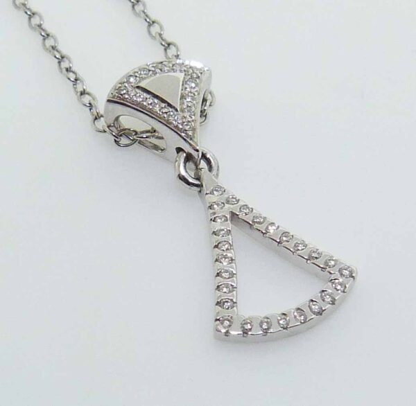 14K white gold pendant set with 39 round brilliant cut diamonds totalling 0.33 carats, H-I, SI1-2, very good cut