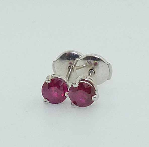 14K white gold stud earrings 3 prong set with 2 round rubies, 0.979cttw and featuring locking backs for extra security.