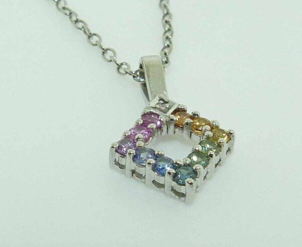 14KW Lady's open offset square pendant set with 11 rainbow coloured sapphires, 0.22cttw, and one 0.01ct diamond, SI.