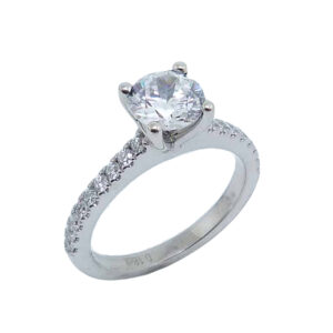 14 karat white gold solitaire engagement ring set in the centre with a 1.0ct CZ and featuring 0.25ctw G/H, VS-SI round brilliant cut diamonds down the band. This unique design is a great alternative to a traditional solitaire ring. Priced without a center gemstone. Let us find you the perfect center that fits your tastes and budget!