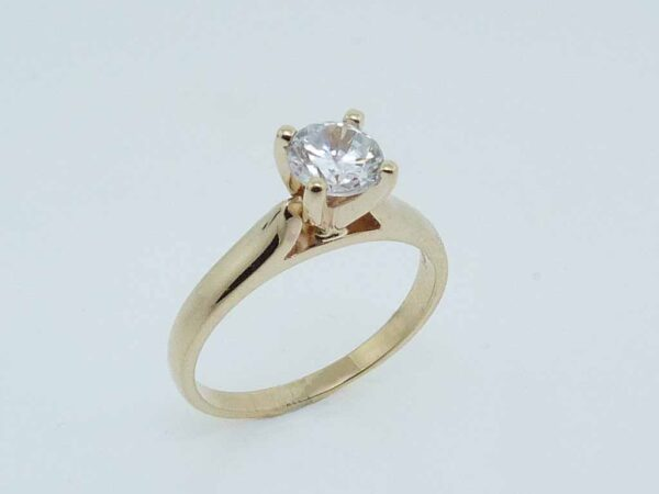 14K yellow gold solitaire engagement ring.