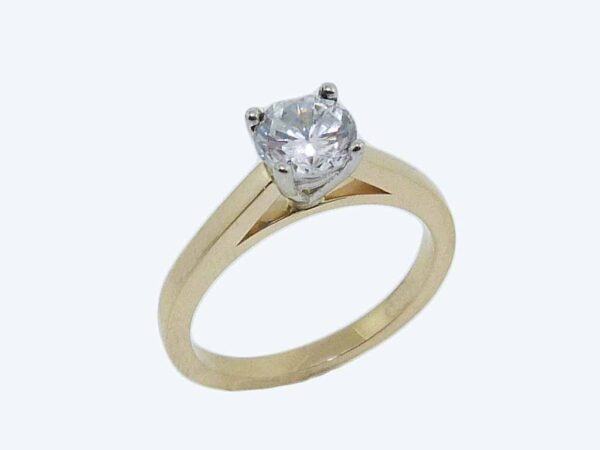18K yellow and white gold solitaire engagement ring.