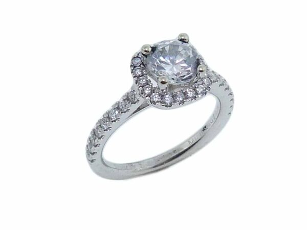 19K white cushion-shaped halo engagement ring accented by 34 = 0.34cttw G/H, VS-SI, round brilliant cut diamonds.