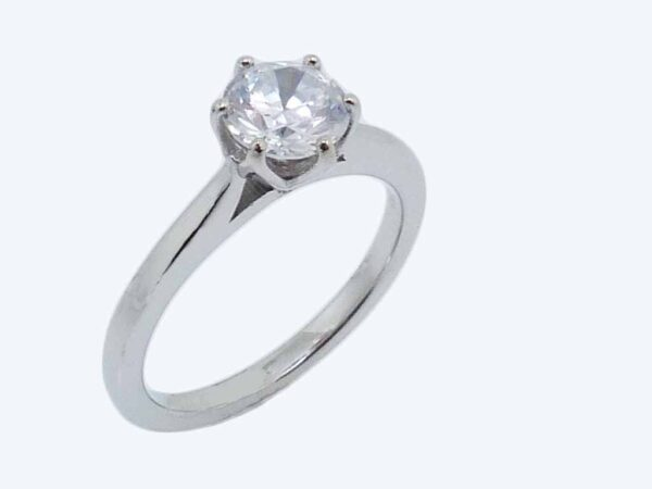 14K white gold six prong solitaire engagement ring.